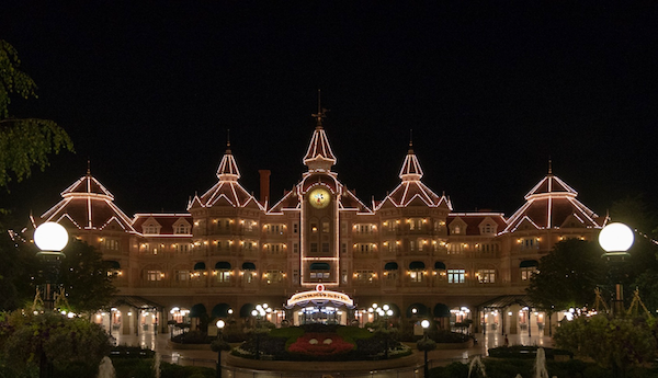 How To Plan For The Best Disneyland Paris Trip Ever, Disneyland Hotel by night at Disneyland Paris