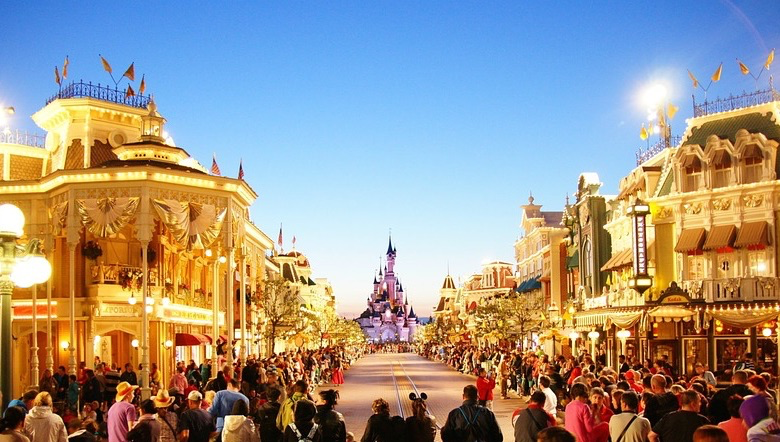Perfect family city breaks in Europe this autumn, Disneyland Paris at night