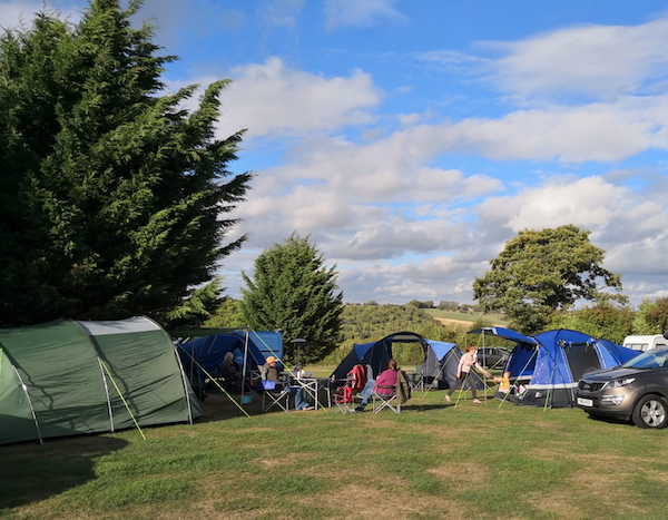 September 2018 Income & Profit Report update, our group of tents pitched at the campsite
