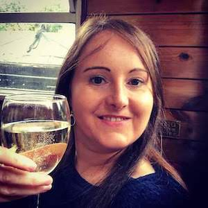 September 2018 Income & Profit Report update, Corinna enjoying a glass of prosecco onboard the canal barge