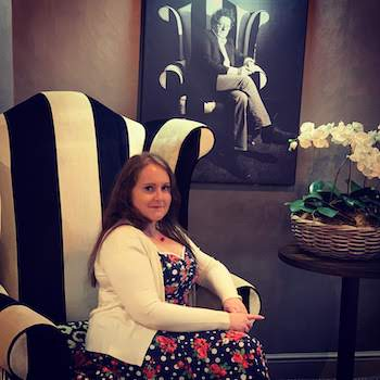 October 2018 Income & Profit Report, Corinna sat in front of a picture of Marco Pierre White